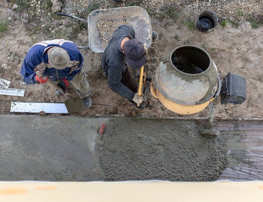 men pouring the cement